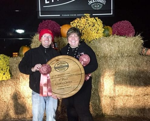Chef Phillip and Leah Dell with awards at the Jack Daniels BBQ Invitational in 2017